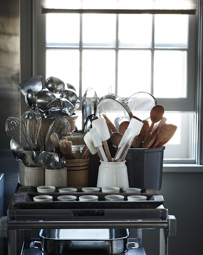 If you don't have enough counter space to keep cooking utensils in plain sight, make space by bringing in a rolling cart. Large pans, ramekins and jars for utensils fit easily, and can be moved around the kitchen easily.