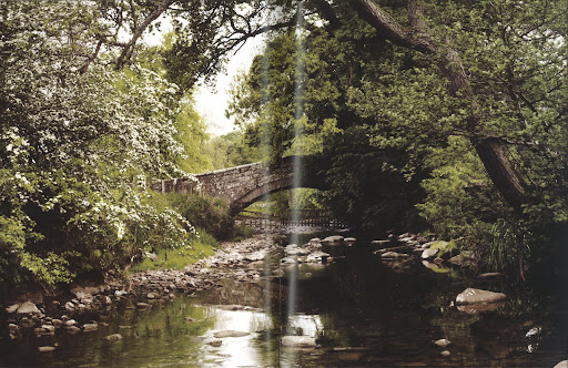 This calm creek resting under this old stone bridge is nothing short of enchanting.