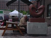 Distillery District: Toronto, June 2004: Man overpowers bench