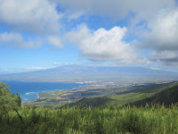 Clouds clearing from the top of Haleakala gives an awesome view of Maui.