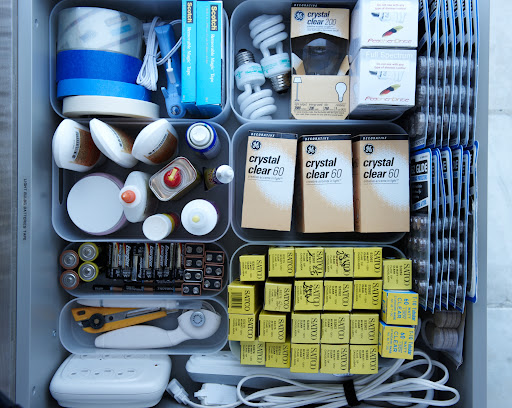 It is smart to have a utility drawer in your kitchen. You never know when a light bulb will burn out or an appliance will run out of batteries. Keep all the essentials in one place, separated with plastic containers.
