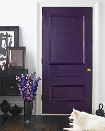 Winter: Although dark-purple walls might be difficult to live with (and hard to paint over), a deep-violet door creates intrigue without overpowering this entryway. The marriage of purple paint and dark wood floors also looks surprisingly classic. The door can be painted over when this darker tone seems too harsh.