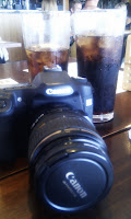 Two cokes and a camera