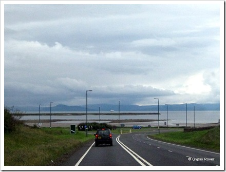 Isle of Arran hidden in cloud with a ferry crossing to Ardrossan.