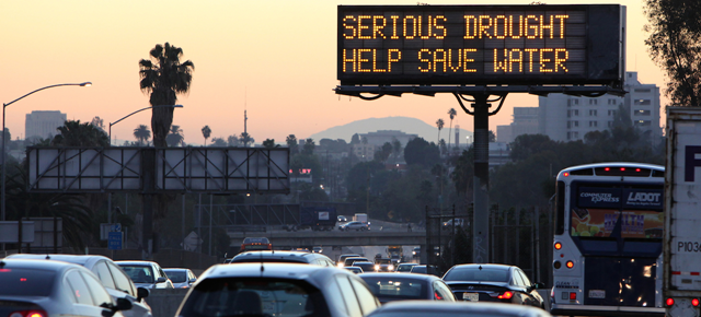 A freeway sign in California reads, 'Serious drought - help save water'. Photo: Richard Vogel / AP