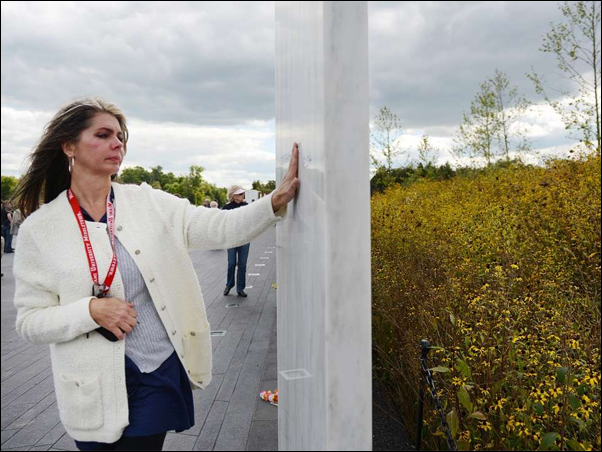 Melissa Taylor, of Cincinnati, visits the Flight 93 memorial near Shanksville. Scientists are blaming insect swarms that weren't there 20 years ago on climate change. Photo: AP