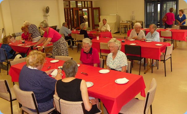 Members of St Anne's Club for the Blind preparing for lunch (and the music!)