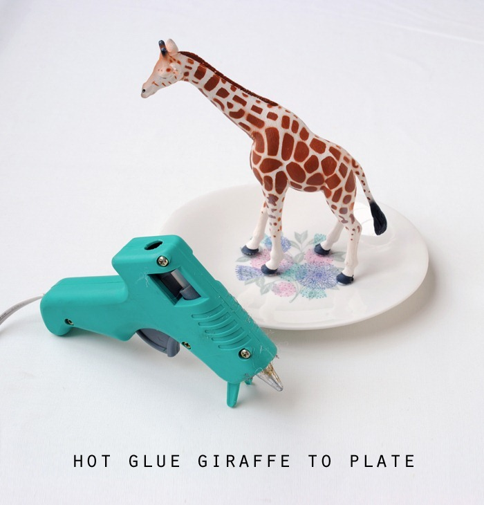 hot glue giraffe to plate