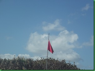 Red Flag means High Hazard but not to surfers