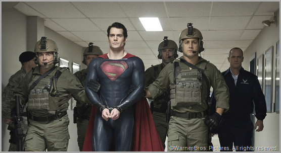 Superman (Henry Cavill) turns himself in to save the human race. CLICK to visit the official MAN OF STEEL site.