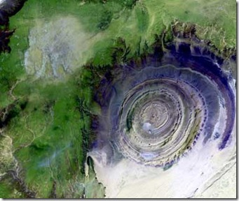 Image taken 1/11/2001: The so-called Richat Structure is a geological formation in the Maur Adrar Desert in the African country of Mauritania. Although it resembles an impact crater, the Richat Structure formed when a volcanic dome hardened and gradually eroded, exposing the onion-like layers of rock.<br /><br />The Richat Structure can be found on Landsat 7 WRS Path 203 Row 45, center: 21.68, -11.94.<br /><br />To learn more about the Landsat satellite go to:<br /><br />http://landsat.gsfc.nasa.gov/<br />