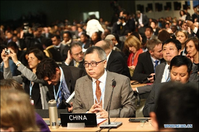 Su Wei (C), deputy chief of the Chinese delegation, attends the opening ceremony of the United Nations Climate Change Conference 2013 in Warsaw, Poland, on 11 November 2013. The annual UN global climate talks started Monday amid hopes that progress will be made toward the signing of a new climate deal by 2015, however no major breakthrough was expected. Photo: Zhang Fan / Xinhua