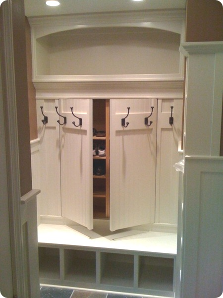 hidden storage for shoes in mud room