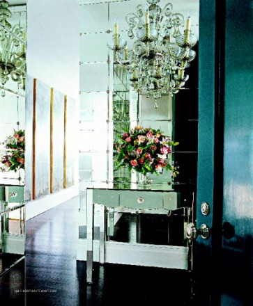 Walls lined with floor-to-ceiling windows open up small spaces, like this foyer (image from MSL, February 2008)