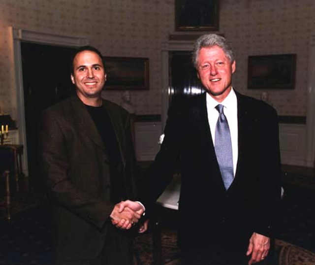 Dr. Andrew Dessler shakes hands with U.S. President Bill Clinton. Dr. Dessler served as a Senior Policy Analyst in the White House Office of Science and Technology Policy for the last year of the Clinton administration. Photo: atmo.tamu.edu