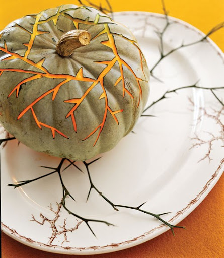 Be creative with your pumpkin carving this year! Green and white pumpkin varietals are often still orange inside, so make the most of shaving down designs without all the effort of excavating seeds. (www.pinterest.com)