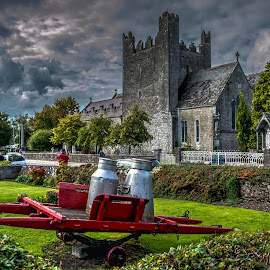 Abbey by Monika Tržić - Buildings & Architecture Places of Worship ( clouds, ireland, church, hdr, green, street, hedge, sky, red, blue, grey, abbey, adare )