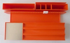 Orange Maul desk storage object with perpetual calendar