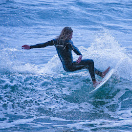 Hanging on by Brent Morris - Sports & Fitness Surfing