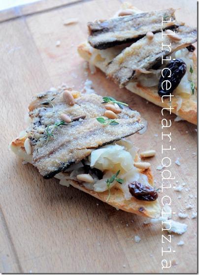 crostoni con sardine gratinate + cipolle ai pinoli e uvetta