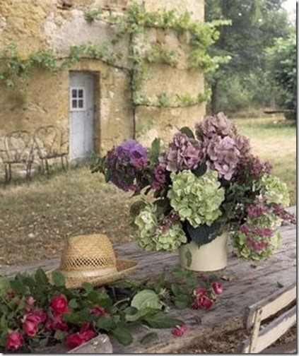 purple and green dired hydrangea outside french home via pinterest