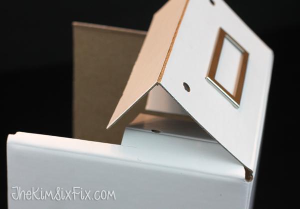Scoring and folding cardboard box
