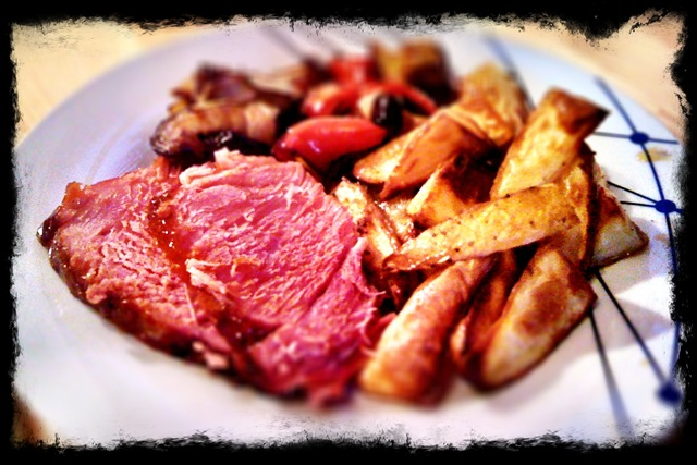 Roast gammon with potato wedges and griddled vegetables