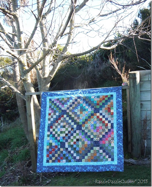 Scrappy trip around the world quilt top