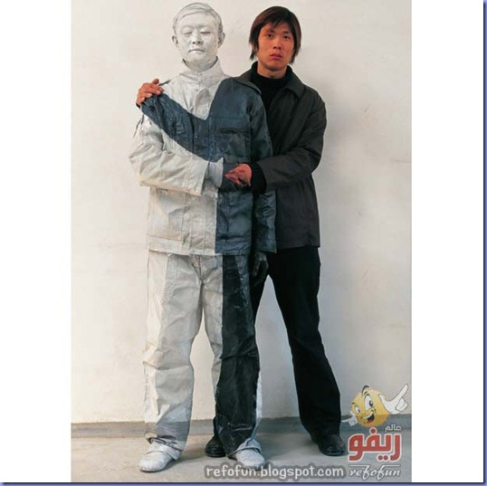 "PIC BY CATERS NEWS - The amazing art of  LIU Bolin, ""THE INVISIBLE MAN "".. In this series called  Hiding in the City .. LIU  uses his body as an art medium by hiding himself in different.. city locations from China to the UK... Liu Bolin was born in 1973 in Shandong, China and graduated from the Sculpture Department of Central.. Academy of Fine Arts with a master degree.....SEE CATERS COPY  mail_sender pix@caternews.com  mail_subject Amazing invisible artist  mail_date Wed, 22 Jul 2009 10:17:16 +0100 (BST)  mail_body   Many Thanks    Adam Harnett  Caters"