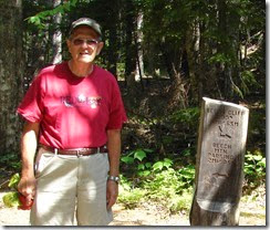 Tom by trails marker