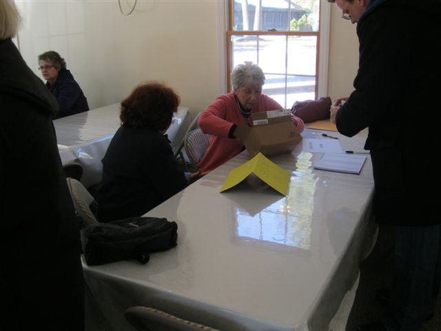 Georgette assists registrants signing in.