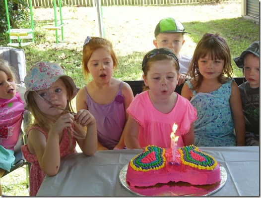 Lilian blowing candles
