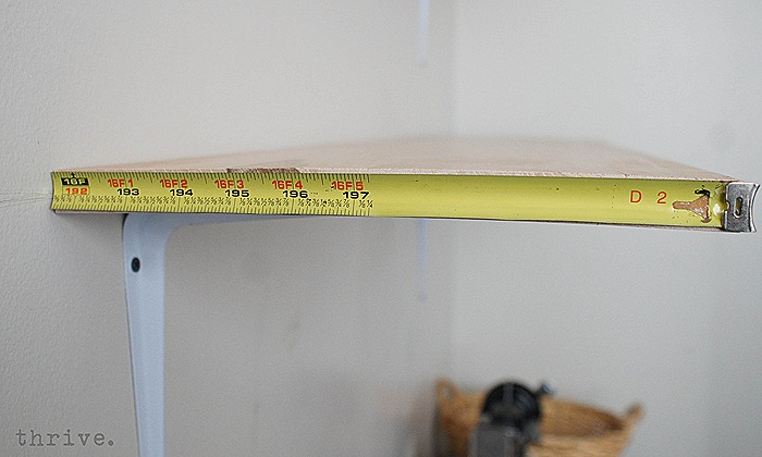 Use a busted tape measure to decorate shelves - choosetothrive.blogspot.com