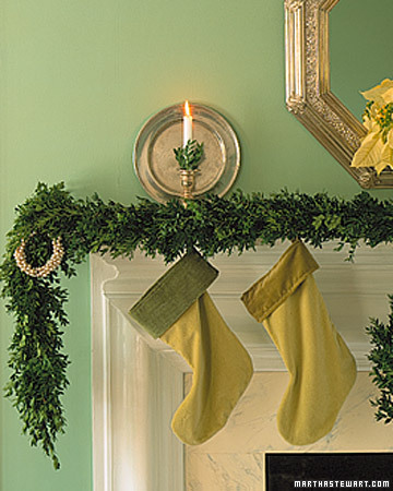 Different shades of green work together on this mantle from the stockings to the greenery to the bobeches in the candlesticks.