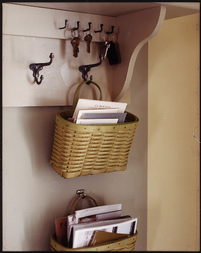 Hooks are another must in an entry.  Great for jackets, keys and pet leashes.  Hang a few baskets on them too for sorting mail.