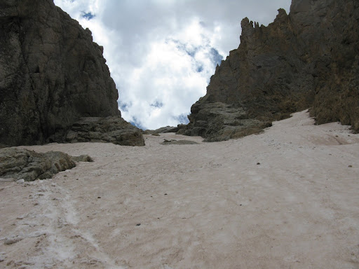 We descend into Ruby Creek basin from the Little Finger saddle. The couloir holds some snow halfway down. It's about 30 degree snow. We both have to self arrest near the bottom.