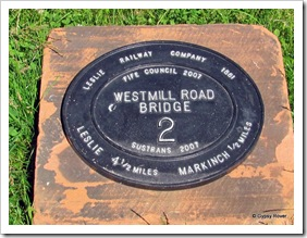 Marker on an ex railway branch line which is now a cycle/walkway.
