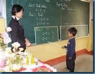 A TEACHER AND