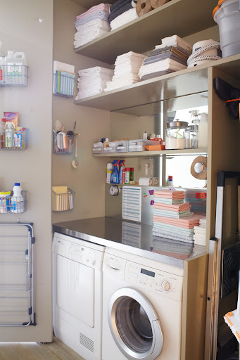 Even utilitarian spaces can benefit from mirror.  The dark closet where my washer and dryer are located is now a bright workspace.