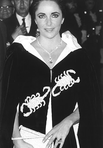 This cape was what Elizabeth wore to Grace Kelly's Scorpion themed birthday in Monte Carlo.  (photo, Elizabeth Taylor:My Love Affair With Jewelry)