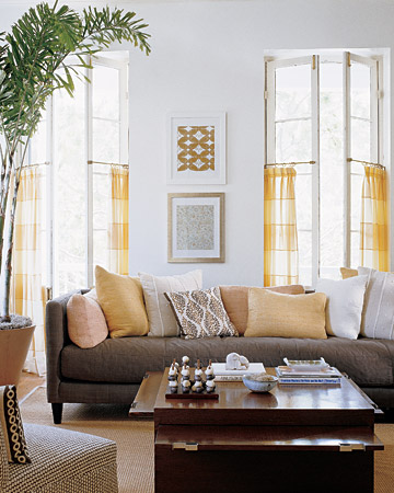 The use of brown and yellow against a crisp gray wall is calming in this sunny room.