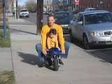 Kai and James riding a mini bike in Denver
