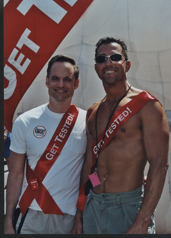 Two men promoting HIV testing at the Los Angeles Christopher Street West (CSW) pride parade. June 13, 1999.