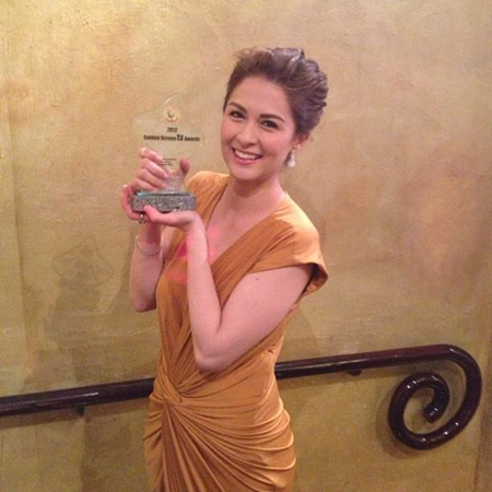 Marian Rivera shows off her trophy as Best Actress
