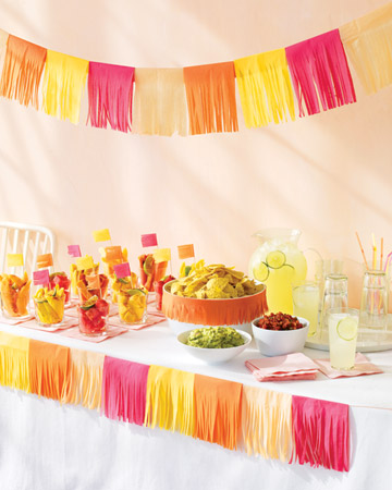 Tissue paper streamers make for vivid table settings. (marthastewart.com)