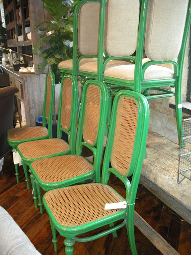 Vintage green chairs, with caning or upholstery.