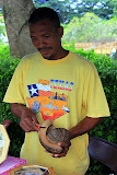 A Local Craftsman Carving Coconut Shells and Husks - Roseau, Dominica