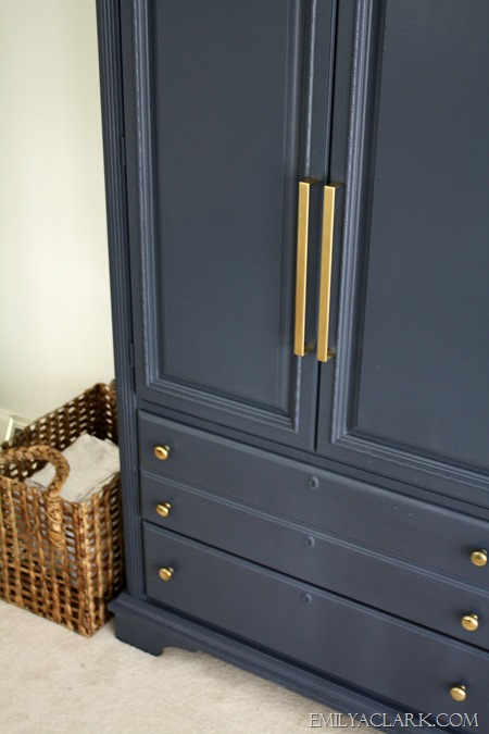 navy armoire with brass knobs