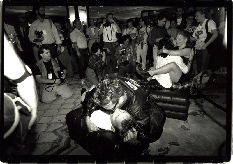 Gay and lesbian couples kissing at an unknown event. Undated.