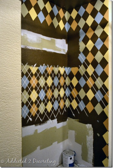 Repurposed closet--coat closet turned utility closet, argyle pattern painted on walls